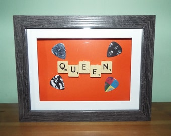 Queen (band) guitar picks with scrabble tiles in a frame Freddie Mercury, Brian May, Roger Taylor, John Deacon