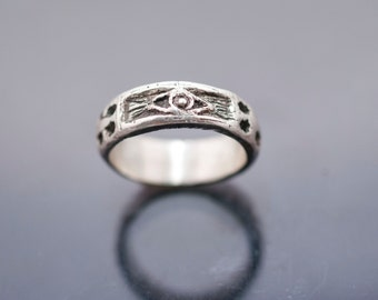 silver ring whit skulls snake cross and eye