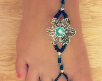 Barefoot sandals with silver and teal flower and black, teal, and silver accents
