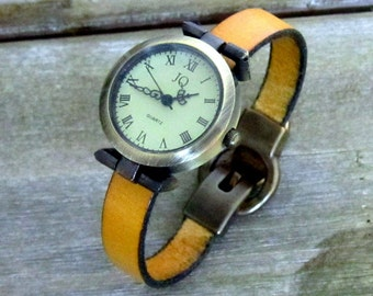 Shows Bracelet leather yellow mustard, dial Bronze, clasp loving old gold color