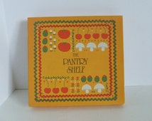 The Pantry Shelf, vintage recipe pocket folder by Regal Canada orange and green book with vegetables on the cover