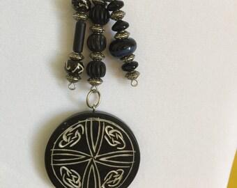 Carved black disc  long pendant with Kathmandu om beads. By BoHoBounty