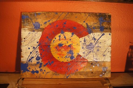 Splatter Paint Colorado Flag on Pallet Wood