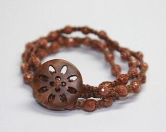 Goldstone and Carved Wood Triple Wrap bracelet.