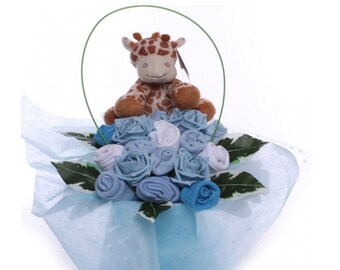 Baby Clothing Arrangement with Giraffe Toy for a Baby Boy.