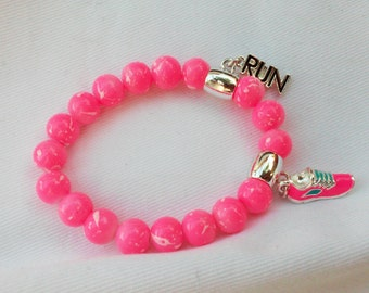"Pink Breast Cancer Awareness Bracelet, Pink And White Beaded Bracelet With Sneaker and ""Run"" Charms"