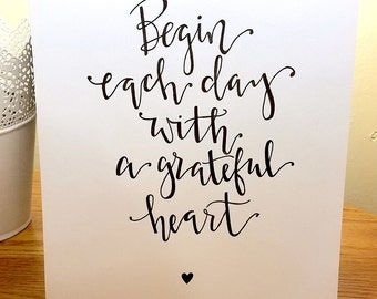 Handwritten Begin each day with a grateful heart quote on a White Cardstock