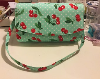 Mint and white polka dot with cherries clutch bag with removable strap