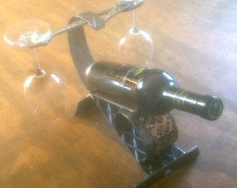 wine bottle and glass sculpture