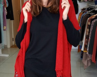 Red  machine-knitted poncho  with hand-knitted details