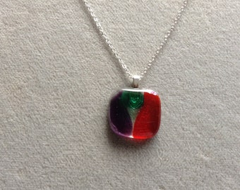 Green, purple, and red orange fused glass