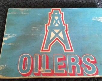Houston Oilers logo on piece of wood