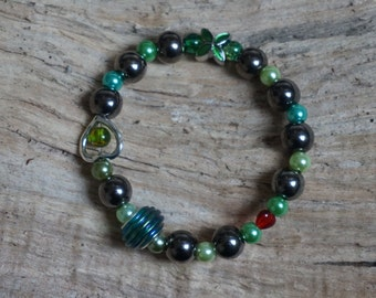 Pearl bracelet of anthracite green beads 2177