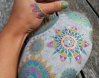 Large stone paperweight with Mandala decoration.