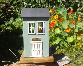Cardboard cottage painted recycled wood-based