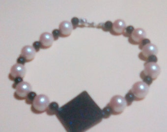 Black and faux pearl bracelet
