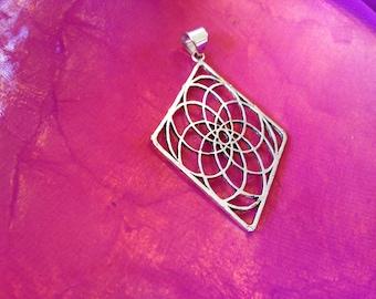 Silver sacred geometry pendant