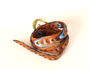 vintage woven leather belt . braided brown and blue chevron belt . 40 inches long . medium large belt