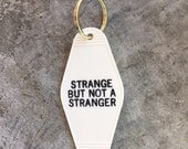 Strange But Not A Stranger Hotel Key Fob with Brass Ring Homage to Talking Heads