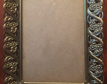 Vintage ornate gold frame. 5x7