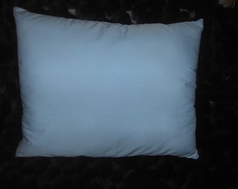 Powder Blue Decorative Cotton Throw Pillow filled with poly fiberfill measures 15.5 x 20 inches.