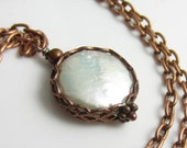 Held Close Necklace - Freshwater Coin Pearl set in Copper Wrap