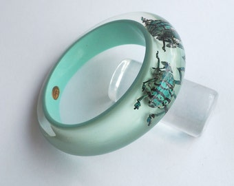 Light blue lucite bracelet with real iridescent insects