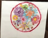 Hand embroidered  100 pct Flour Sack Towel embroidered with a 6 inch circle of flowers