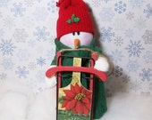 Holiday snowman with his wooden sled: stuffed snowman table top decoration