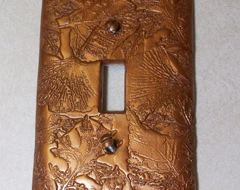 Collage of leaves in antique bronze single toggle light switch cover