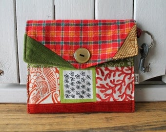 Orange and green pouch with key ring,  green, orange,  floral, fabrics, patchwork, flowers