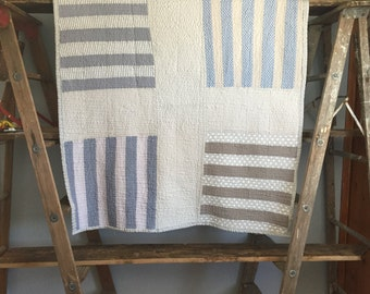 lap throw or baby quilt -- subtle cross -- grey and blue
