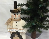 Primitive feed the crows snowman