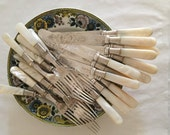 Set of 12 Fabulous Knives and Forks in Mother of Pearl and Silver. Engraved Blades and Tines. English, Circa 1880s Victorian. One of a Kind!