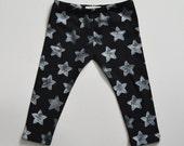 Star print baby leggings on black spandex jersey, hand stamped