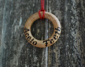 Harry Potter accio teething ring or necklace. Made with Maple rings from the U.S.A and sealed with organic beeswax