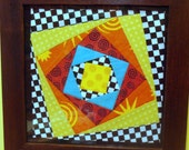 Framed Quilt Block in Orange and Green Squares