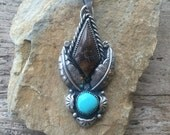 Reserved............Petrified wood and campitos turquoise sterling silver pendant. Handmade artisan pendant.