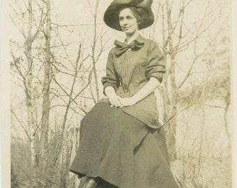 vintage photo 1917 Tall & Pretty Young Woman Sits Poised on Tree Stump Big Hat