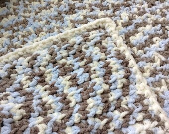 Crochet afghan crib or stroller blanket in blue and cream