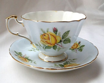 Vintage Paragon Pale blue teacup with yellow roses