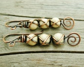 XXXOOO Criss Cross Wrapped Riverstone beads with antiqued copper and open swirls dangle earrings