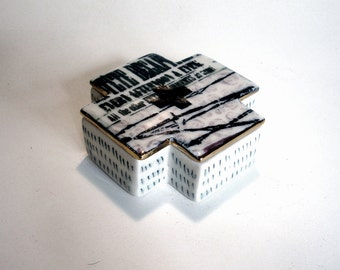 porcelain square cross box with silkscreened underglaze and underglaze pencil pattern and gold luster