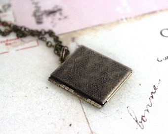 book locket necklace. brass ox with etched lines
