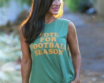 Vote for Football Season. 8 colors to choose from- pick your team colors. Boyfriend Muscle Tee. Made in the USA. Women's Football Shirt.