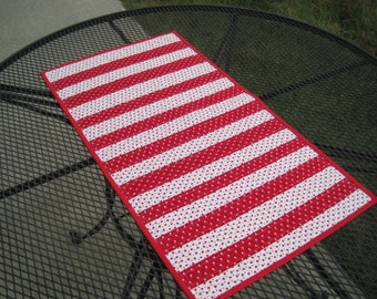 Red and white quilted table runner, 31 x 17, with hearts. Now on sale. Was 17.00. Now 10.00.