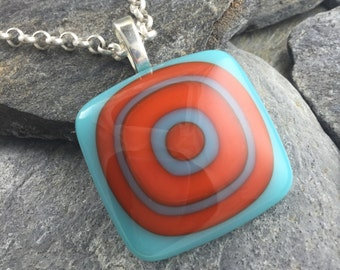 Glass Pendant Design in Turquoise and Orange. Bullseye Design. Colorful Pendant. Fused Glass Pendant. Modern Jewelry.