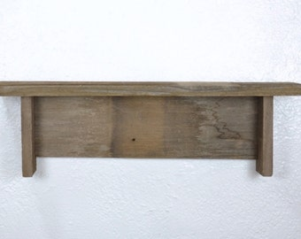 "Wood wall shelf 17"" by 3.75"" with a mix of light and dark patinas handcrafted in the USA"