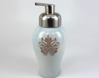 Light blue glazed porcelain foam soap dispenser with hand drawn flourish and brushed nickel pump