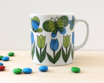 1970s coffee mug, green and blue tulips and butterflies.
